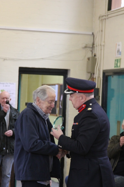 John Mackay being given his plaque